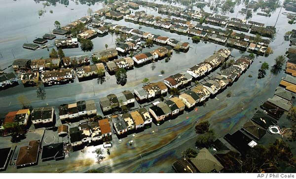 This is an aerial view of a flooded neighborhood on the east side of New Orleans, La., Thursday, Sept. 1, 2005 after Hurricane Katrina passed through the area last Monday morning.(AP Photo/Phil Coale)