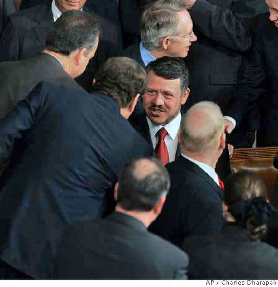 King Abdullah of Jordan is greeted by members of Congress as he arrives to address a joint meeting of Congress, Wednesday, March 7, 2007 on Capitol Hill in Washington. Senate Majority Leader Harry Reid of Nev. is behind the king. (AP Photo/Charles Dharapak) Photo: Charles Dharapak