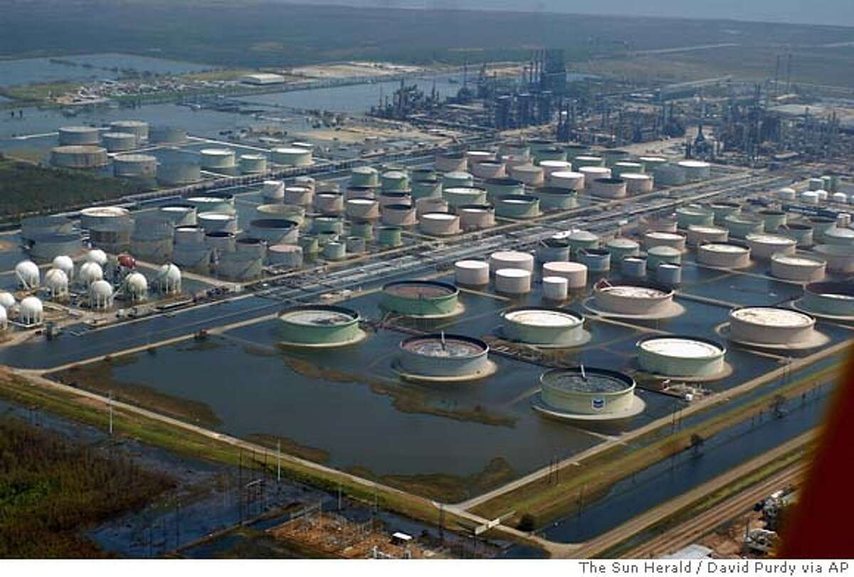 Floodwaters from Hurricane Katrina surround the Chevron refinery in Pascagoula, Miss., Wednesday, Aug. 31, 2005. (AP Photo/The Sun Herald, David Purdy)