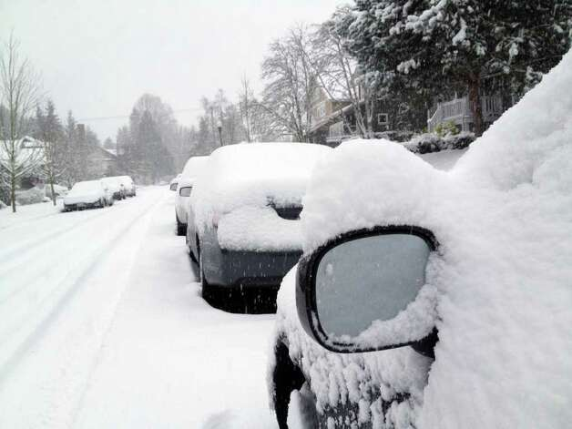 Snow blankets cars and homes in Tacoma, Wash., Wednesday, Jan. 18, 2012.    A widespread snowstorm walloped western Washington on Wednesday with the heaviest blow missing Seattle and hitting the Olympia area, causing accidents, closing schools and canceling flights at Sea-Tac Airport. Photo: AP
