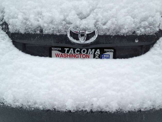 Snow piles up on a car bumper in Tacoma, Wash., Wednesday, Jan. 18, 2012.  A widespread snowstorm walloped western Washington on Wednesday with the heaviest blow missing Seattle and hitting the Olympia area, causing accidents, closing schools and canceling flights at Sea-Tac Airport. Photo: AP