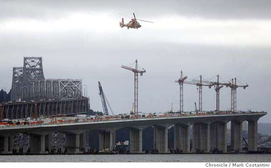 Bay Bridge construction as seen from east side of the bridge. BAYBRIDGE08 -- The cost of the Bay Bridge reconstruction just jumped another $140 million. The $140 million will come out of the roughly $900 million contingency fund. 15 inches. photo: Mark Costantini / San Francisco Chronicle  Event on 3/7/07 in Oakland, CA Photo: Mark Costantini