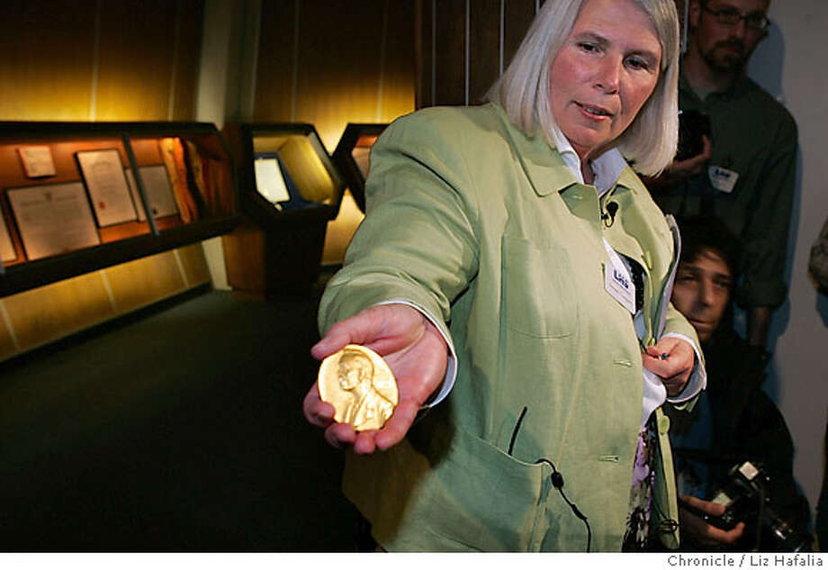 Susan Gregory, deputy director of the Lawrence Hall of Science, shows returned coin here. Left of her is the six sided encasement it was stolen from. A UC Berkeley biology student, Ian Michael Sanchez, 22, who worked at the Lawrence Hall of Science, was taken into custody today and booked on suspicion of felony grand theft for allegedly stealing the first Nobel Prize, a 23-karat gold medal worth $4,200, UC Berkeley police said. Photographed by Liz Hafalia/BERKELEY/3/7/07  **Susan Gregory, Ian Michael Sanchez cq Photo: Liz Hafalia