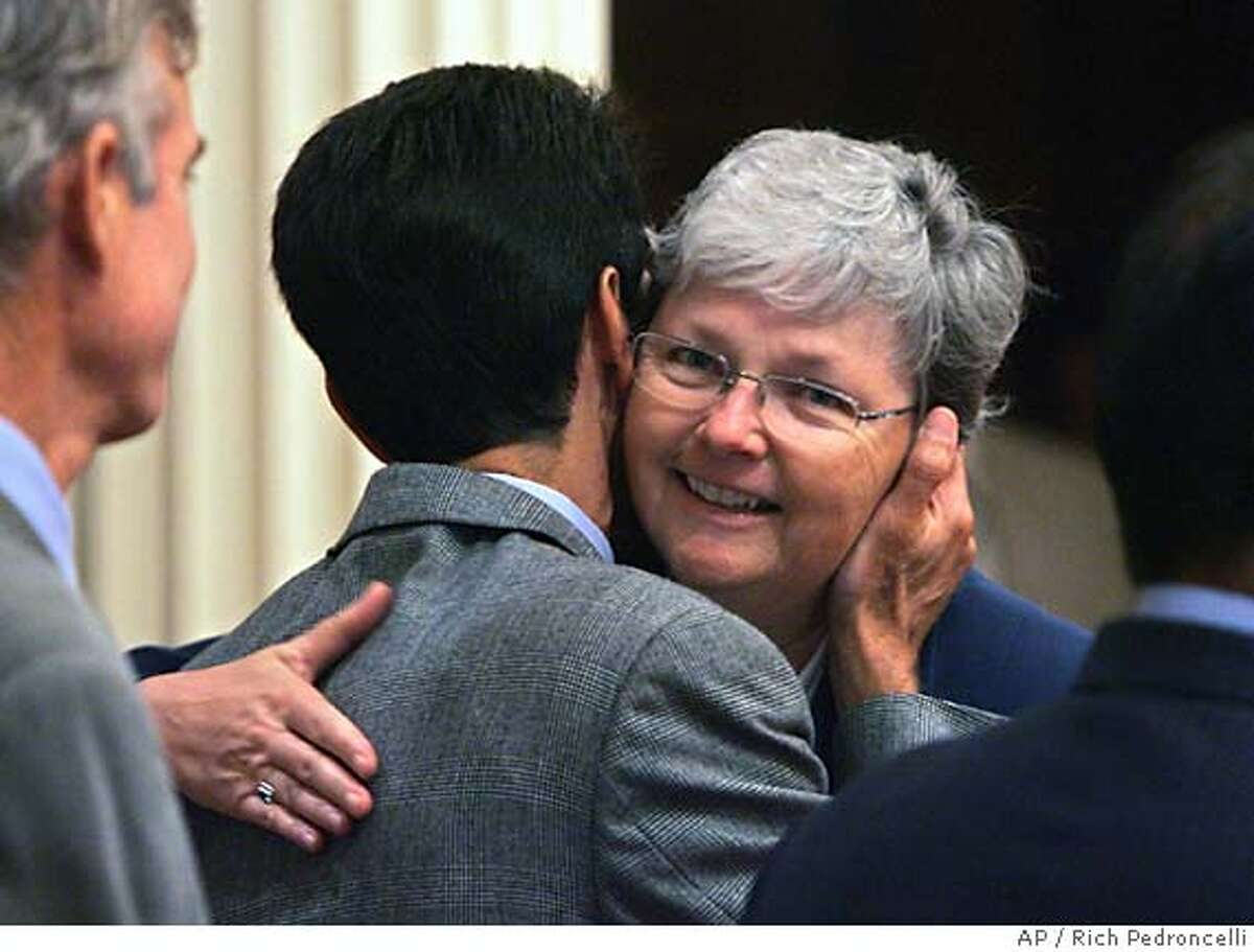 State Sen. Christine Kehoe, D-San Diego, right, one of the Legislature's six gay members, hugs Assemblyman Mark Leno, D--San Francisco, left, after his same-sex marriage bill was approved by the Senate during the session held at the Capitol in Sacramento, Calif., Thursday, Sept. 1, 2005. The 21-15 vote made the Senate the first legislative chamber in the country to apprvoe a bill. The bill will be sent to the Assembly which narrowly rejected a bill in June.(AP Photo/Rich Pedroncelli)