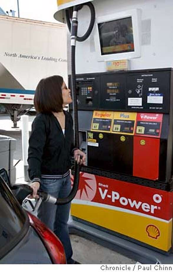 Karol Wong fills her tank while watching a video screen displaying advertisements at a Shell station at 7th Avenue and Lincoln in San Francisco, Calif. on Tuesday, March 6, 2007. Shell hopes to have as many as 75 stations equipped with the new video pumps by the end of the month.  PAUL CHINN/The Chronicle  **Karol Wong MANDATORY CREDIT FOR PHOTOGRAPHER AND S.F. CHRONICLE/NO SALES - MAGS OUT Photo: PAUL CHINN