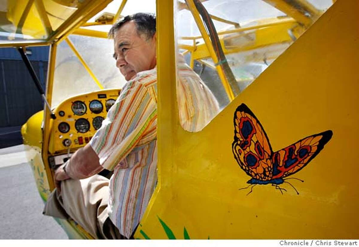 """kitplanes_097_cs.jpg Event on 9/15/06 in Petaluma. Carlos Garza, 66, of Petaluma sits in his home-made experimental airplane at Petaluma Airport. The yellow and green plane is a """"Kit Fox,"""" which he named """"Bird of Paradise"""" sports a colorful assemblage of birds, butterflies, plants and other tropical designs. Chris Stewart / The Chronicle Experimental Aircraft Association Ran on: 03-06-2007 Carlos Garzas Kitfox, which he keeps at the Petaluma airport, is the fourth plane hes built. He named it Bird of Paradise."""