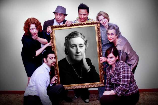 "The cast of ""The Mousetrap""  hoists a photo of playwright Agatha Christie. Photo: Ryan Menner, Courtesy"