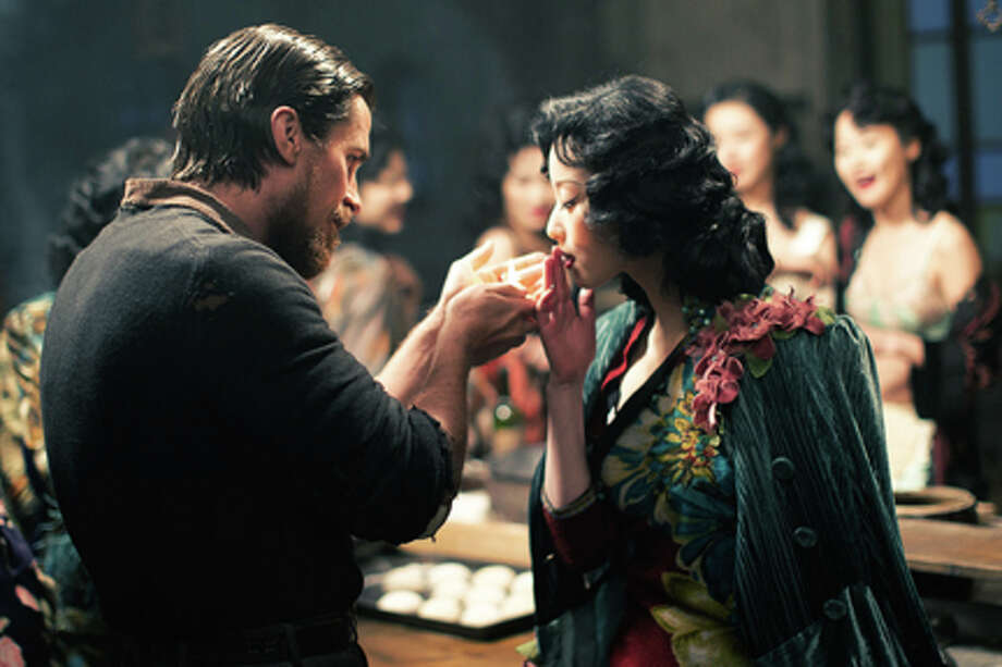 "Christian Bale as John Miller and Ni Ni as Yu Mo in ""The Flowers of War."" / WREKIN HILL ENTERTAINMENT"