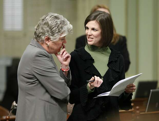 Assemblywoman Kristin Olsen, R-Modesto, right, talks with Assemblywoman JUlia Brownley, D-Santa Monica during the Assembly session at the Capitol in Sacramento, Calif., Tuesday, Jan. 17, 2012.  Gov. Jerry Brown will give his State of the State address before a joint session of the Legislature on Wednesday, Jan. 18. (AP Photo/Rich Pedroncelli) Photo: Rich Pedroncelli, Associated Press