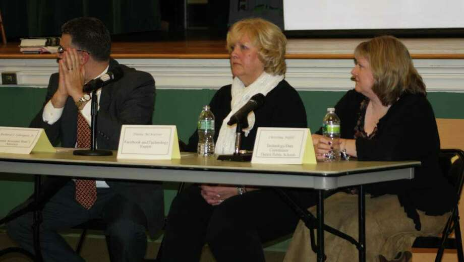 From left: Richard J. Colangelo, Jr., senior assistant state attorney; Diane McKeever, Facebook and technology specialist and Christina Hefele, technology/data coordinator at Darien Public Schools discuss ways to keep children safe when using social media. Photo: Ben Holbrook