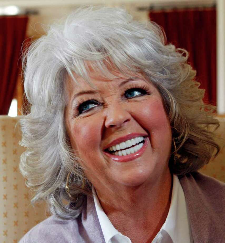 In this Dec. 30, 2010 photo, Paula Deen speaks in Pasadena, Calif. Paula Deen is out of her element. Instead of a kitchen, the Food Network's Southern-cooking queen was holding court in a lavish hotel suite. And instead of being home for the holidays in Savannah, Ga., she's ringing in the new year serving as grand marshal of Saturday's Tournament of Roses Parade in Pasadena, Calif.  (AP Photo/Nick Ut) Photo: Nick Ut / AP