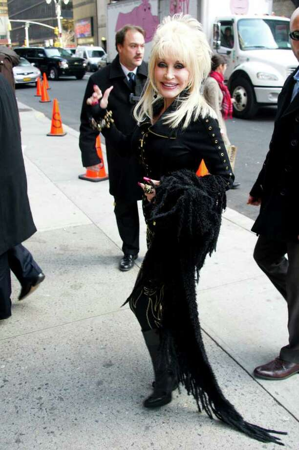 "Dolly Parton arrives for a taping of the ""Late Show with David Letterman,"" in New York, Wednesday, Jan. 11, 2012. (AP Photo/Charles Sykes) Photo: Charles Sykes / FR170266 AP"