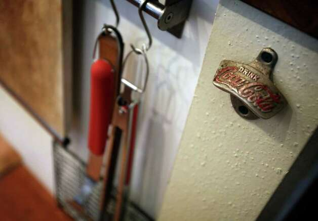 An old fashion bottle opener is attatched to a wall just below a counter in the kitchen of Nancy and Eric Johnson.  Friday, Jan. 13, 2012.  Photo Bob Owen/rowen@express-news.net Photo: BOB OWEN, SAN ANTONIO EXPRESS-NEWS / rowen@express-news.net