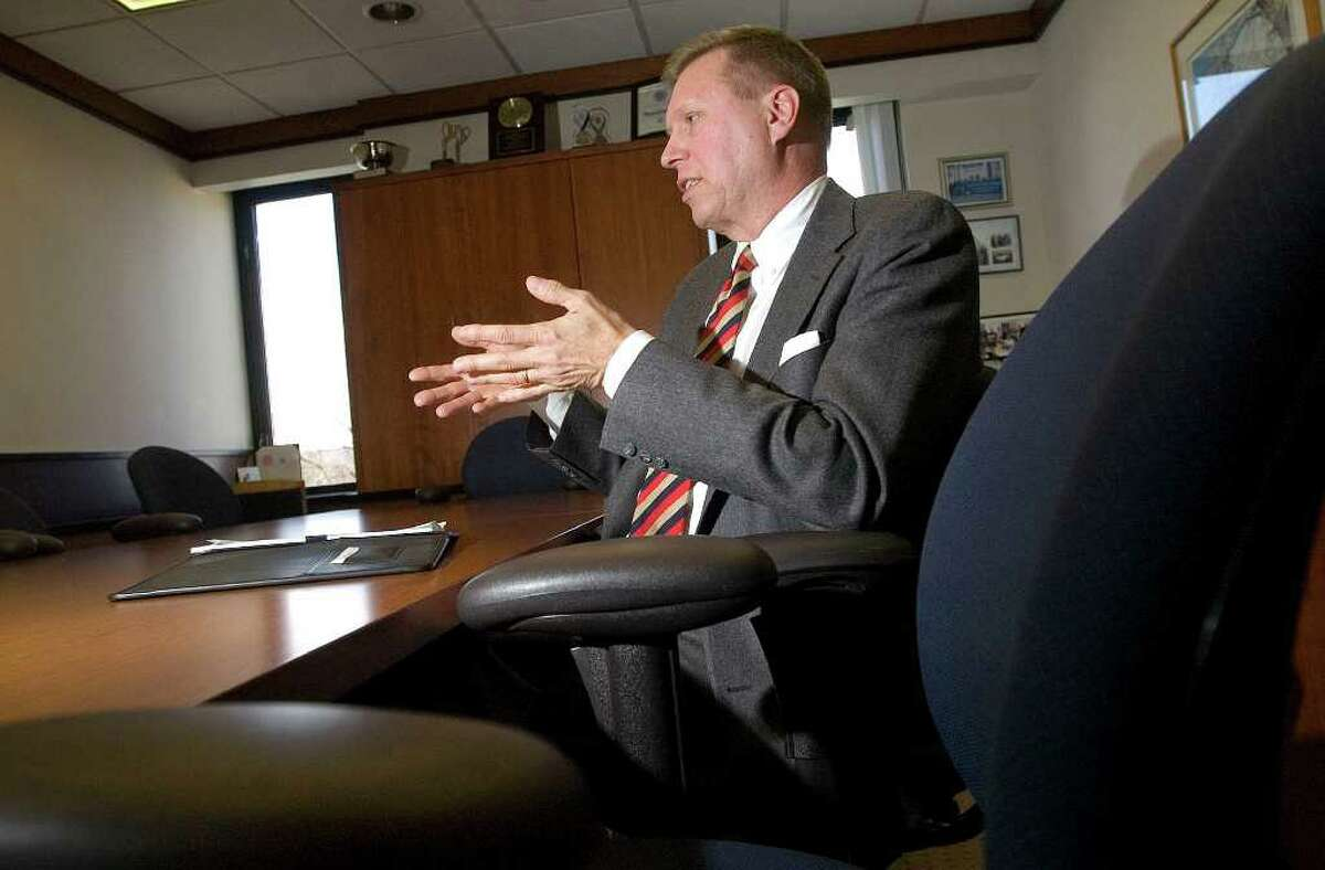 Bruce Tuomala answers questions from a reporter at Danbury City Hall on Wednesday, Jan. 18, 2012. Tuomala is the city's new economic development director.