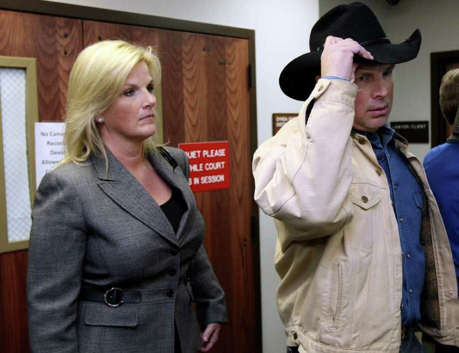 In this Jan. 17, 2012 photo, country music stars Garth Brooks, right, and Trisha Yearwood leave the courtroom at Rogers County Courthouse, in Claremore, Okla. Brooks is suing Integris Canadian Valley Hospital for the return of a donation he made in 2005. (AP Photo/Tulsa World, Cory Young) Photo: Cory Young