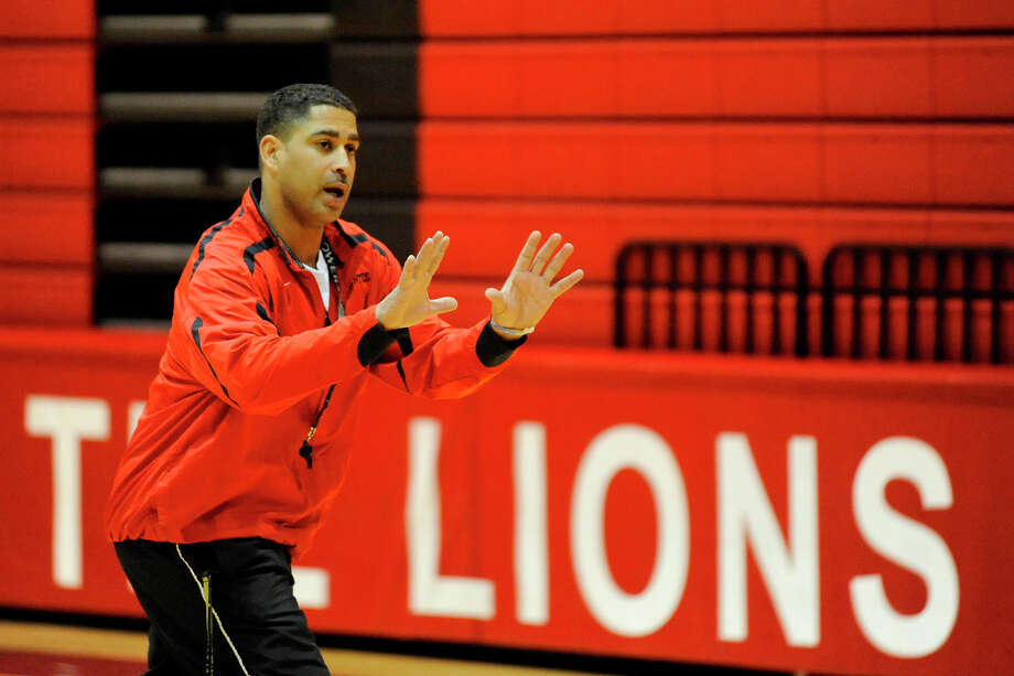 Kountze head basketball coach Duane Joubert works with his team during a Saturday practice at the Lions Den gym to prepare for their next round of playoffs on Monday in Livingston.   February 27, 2010.  Valentino Mauricio/The Enterprise Photo: Valentino Mauricio / Beaumont