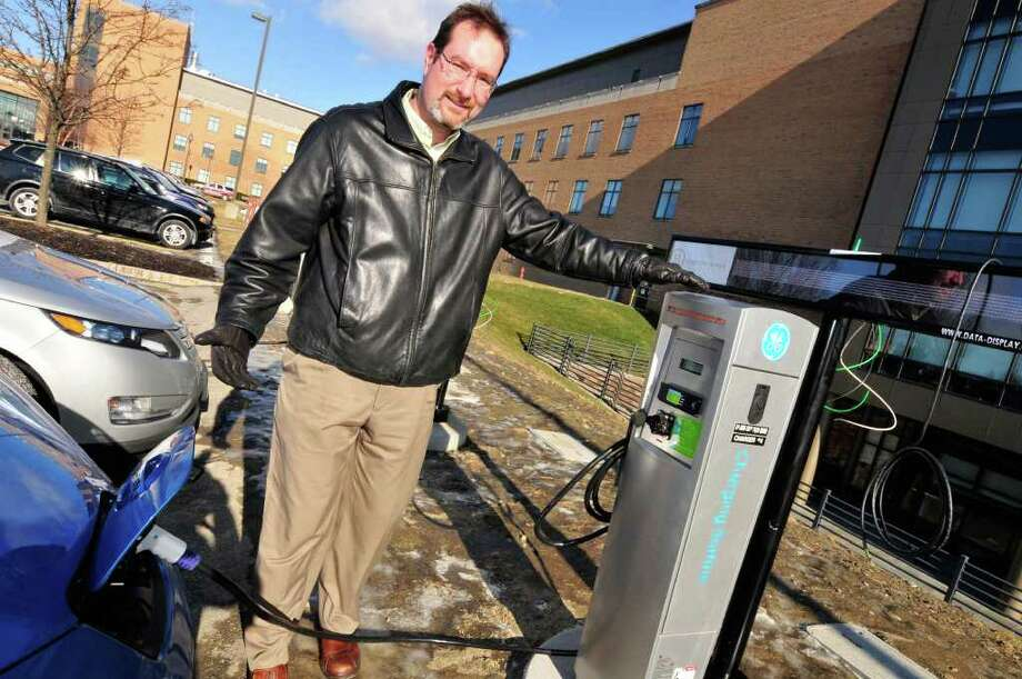 Matt Nielsen , principal scientist EV research , at GE Global Research at the five electric car charging stations in Niskayuna,NY Wednesday, Jan.18, 2012. The electric vehicles pictured are the Chevy Volt and Nissan LEAF.( Michael P. Farrell/Times Union) Photo: Michael P. Farrell