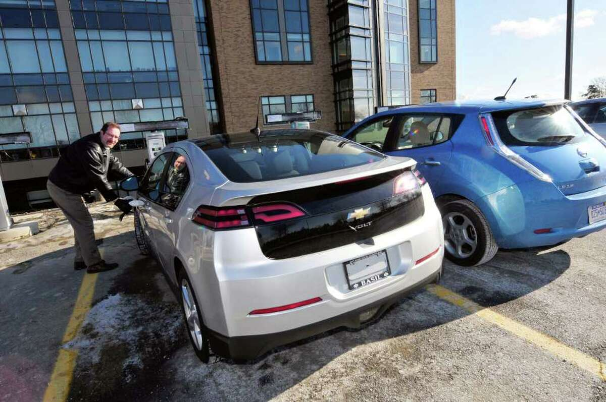 Matt Nielsen , principal scientist EV research , at GE Global Research at the five electric car charging stations in Niskayuna,NY Wednesday, Jan.18, 2012. The electric vehicles pictured are the Chevy Volt and Nissan LEAF.( Michael P. Farrell/Times Union)