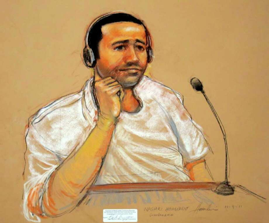 FILE - This Nov. 9, 2011, file artist rendering by courtroom artist Janet Hamlin, reviewed by the U.S. military, shows Abd Al Rahim Hussayn Muhammad Al Nashiri, accused of setting up the bombing of the USS Cole, is depicted during his military commissions arraignment at the Guantanamo Bay detention center in Guantanamo, Cuba.  A copy of a magazine published by an arm of al-Qaida made its way to a terror suspect at the Guantanamo Bay prison, leading to an inspection of cells and a contentious new policy requiring special review teams to examine correspondence between prisoners and attorneys, U.S. prosecutors said Wednesday.  (AP Photo/Janet Hamlin, File) Photo: Janet Hamlin / AP POOL