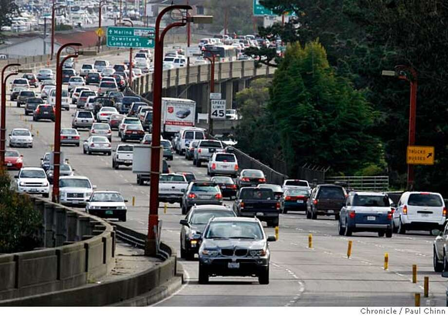 The morning commute clogs the southbound lanes of Doyle Drive, the elevated portion of Highway 101 stretching from the Golden Gate Bridge to Lombard Street, in San Francisco, Calif. on 3/15/06. Transportation officials are taking public comment until the end of the month on the design of a federal, state and locally funded seismic upgrade and widening of the roadway.  PAUL CHINN/The ChronicleRan on: 03-18-2006  Doyle Drive, traveled by 91,000 cars a day going to and from the Golden Gate Bridge, needs significant upgrades.Ran on: 03-18-2006  Doyle Drive, traveled by 91,000 cars a day going to and from the Golden Gate Bridge, needs significant upgrades. MANDATORY CREDIT FOR PHOTOG AND S.F. CHRONICLE/NO SALES - MAGS OUT Photo: PAUL CHINN