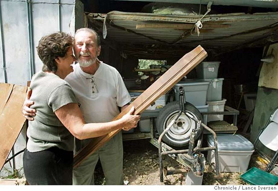 RITA30_1386.jpg_  Disaster evacuees from Holly Beach Louisiana Chris & Ron Robicheaux recover pieces of Ron's grandmothers 160 year old armoire that was destroyed when a oak tree crashed through the home they were staying in DeRidder LA while riding out hurricane Rita. By Lance Iversen/San Francisco Chronicle MANDATORY CREDIT PHOTOG AND SAN FRANCISCO CHRONICLE. Photo: Lance Iversen