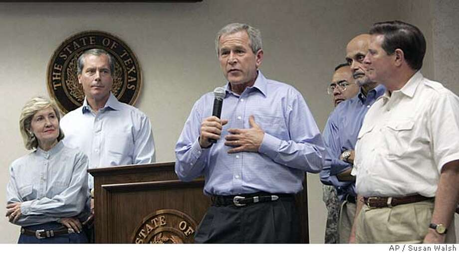 President Bush talks to the staff at the Texas Emergency Operations Center in Austin, Texas., Saturday, Sept 23, 2005. Bush, seeking to project a take-charge role on Hurricane Rita, declared satisfaction Saturday with the government's storm preparations as he hopskotched the country from one high-tech disaster command center to another. Standing with Bush are from left, Sen. Kay Bailey Hutchison, R-Texas, unidentified, Bush, unidentified, Secretary of Homeland Security Michael Chertoff, and House Majority Leader Tom Delay, R-Texas. (AP Photo/Susan Walsh) Photo: SUSAN WALSH