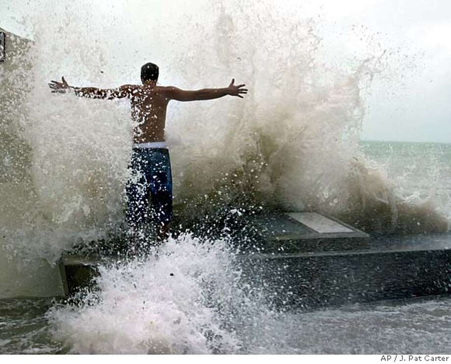 Joe McGee stands in the pounding surf at the Southern Most Point in Key West, Fla. Tuesday, Sept. 20, 2005, as Hurricane Rita neared the lower Florida Keys. (AP Photo/J. Pat Carter) Photo: J. PAT CARTER