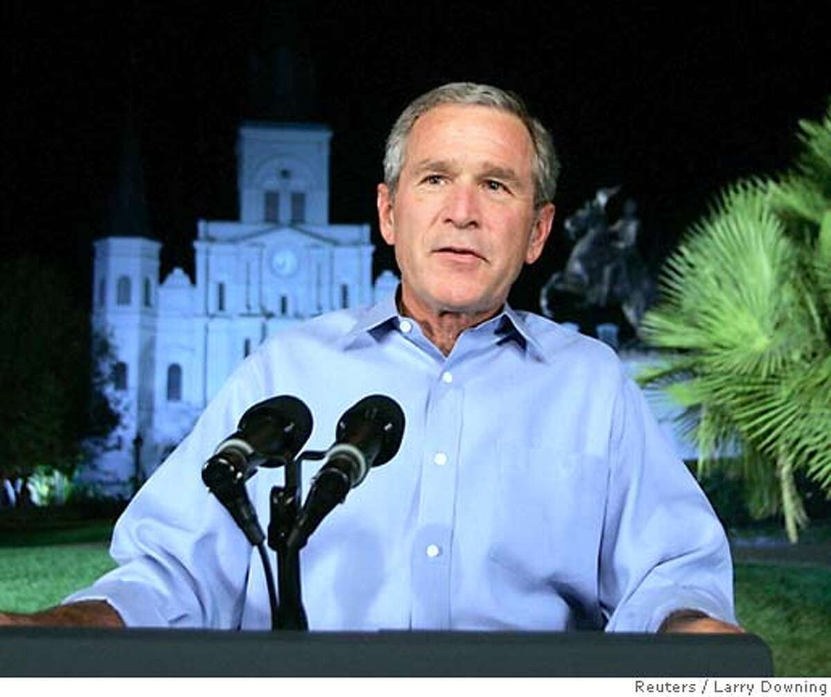 """U.S. President George W. Bush speaks about Hurricane Katrina's damage to the nation, on network television from Jackson Square in New Orleans September 15, 2005. Bush believes the vision for rebuilding should be """"locally inspired"""" but that the country as a whole needs to be committed to that longer-term effort. The president will continue to the White House following the speech. REUTERS/Larry Downing"""