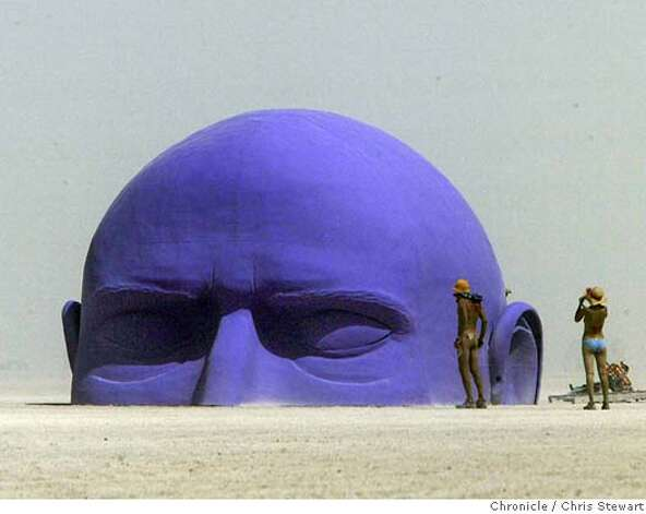 The Dreamer rises from the Black Rock desert during a dust storm at Burning Man 2005, Monday, August 29, 2005 on the playa. burnman2005  Chris Stewart / The Chronicle Photo: Chris Stewart