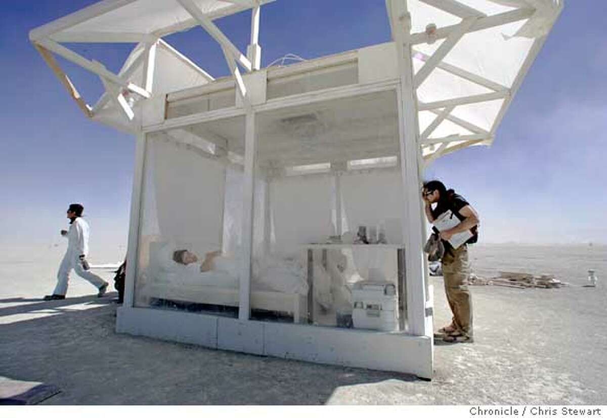 Dicky Davies begins his first day in a plastic box at Burning Man 2005, Monday, August 29, 2005 on the playa at Black Rock desert. Davies will spend the entire week in his box - sleeping, eating, writing and whatever - all on public display. burnman2005 Chris Stewart / The Chronicle