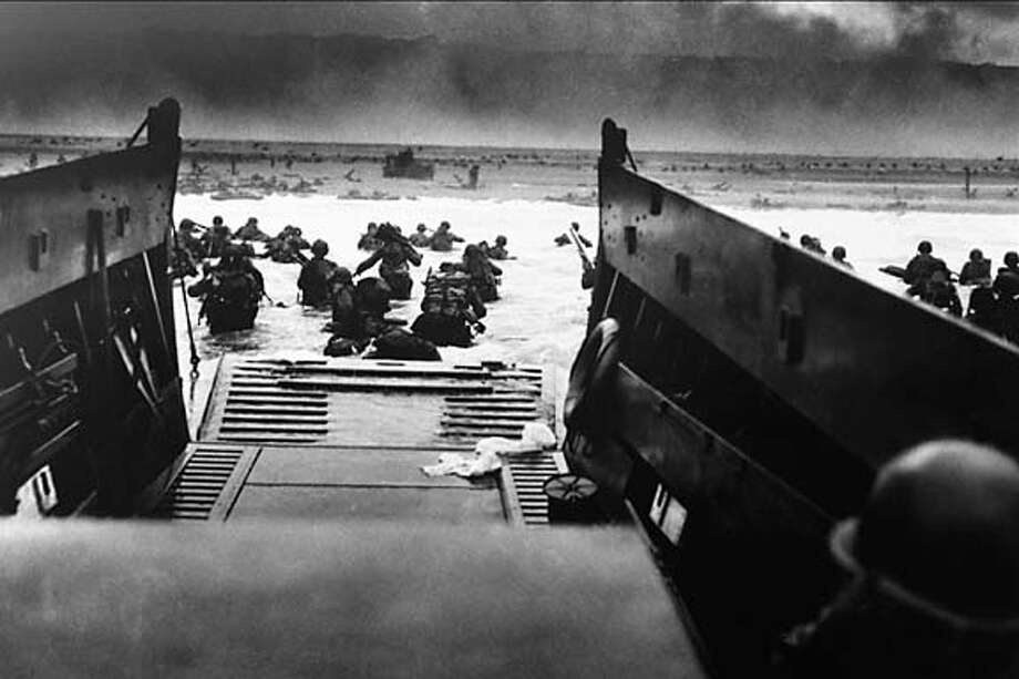 Great crusade: One of only 10 pictures by war photographer Robert Capa shows soldiers storming the beach on D-Day.  Photo by Robert Capa, courtesy of National D-Day Museum