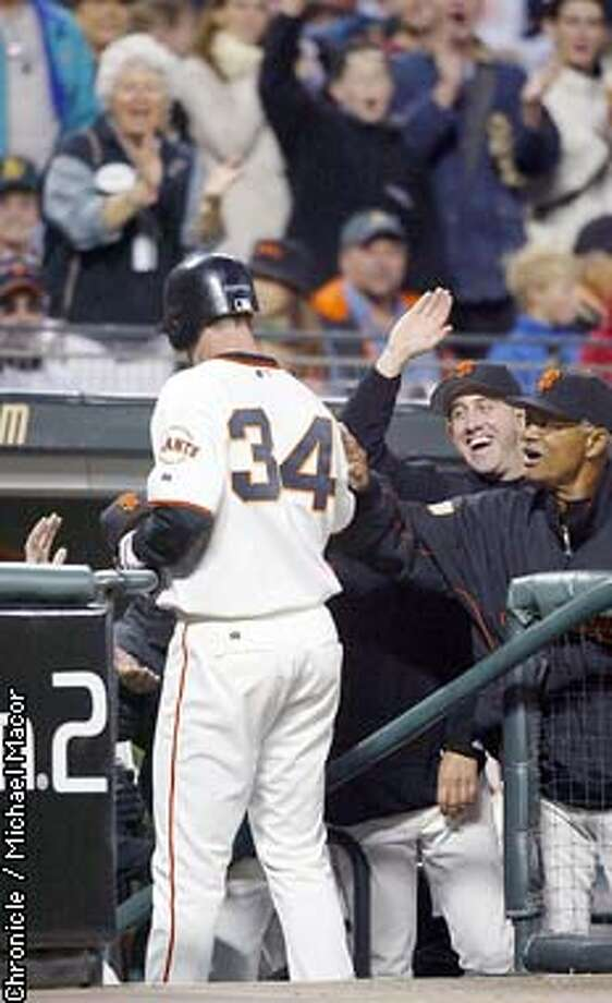 giants092 starting pitcher 34-Jesse Foppert is congratulated by Kirk Rueter and manager Felipe Alou after he is scored by Ray Durham, Foppert tripled to center field in the inning. 5th inning action.  San Francisco v. Colorado Rockies. by Michael Macor/The Chronicle Photo: MICHAEL MACOR