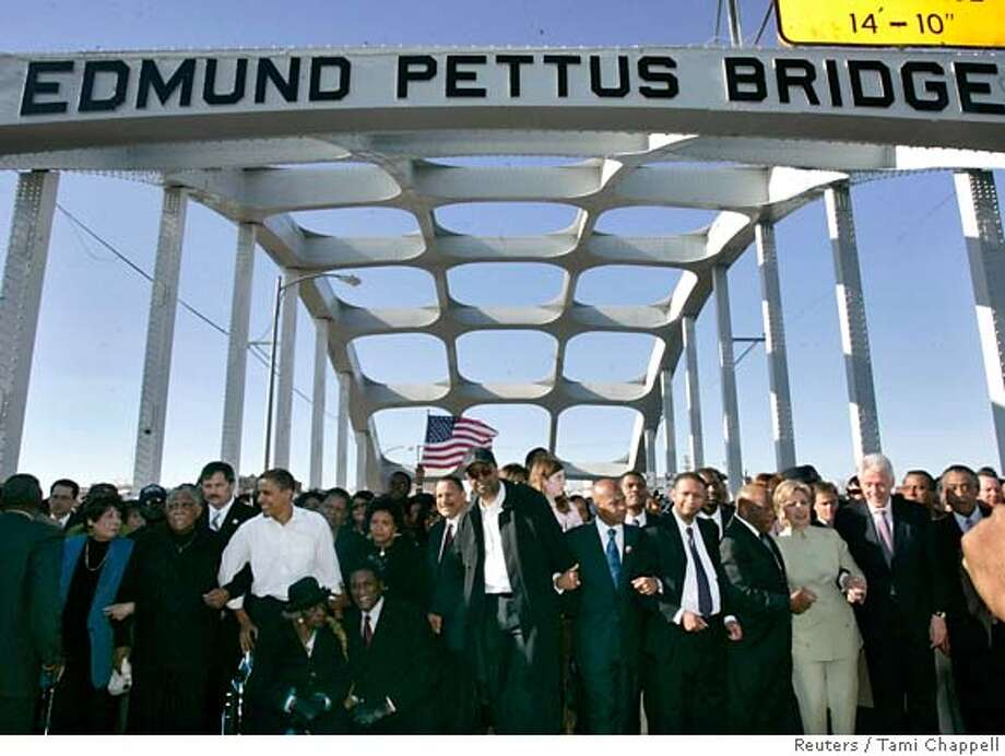 U.S. senators and presidential candidates Barack Obama (D-IL) (front row, 3rd L) and Hillary Clinton (D-NY) (front row, 3rd R) with her husband, former U.S. President Bill Clinton (front row, 2nd R) pause along the Edmund Pettus Bridge during a march commemorating the 1965 Selma-Montgomery Voting Rights March in Selma, Alabama, March 4, 2007. REUTERS/Tami Chappell (UNITED STATES) 0 Photo: TAMI CHAPPELL