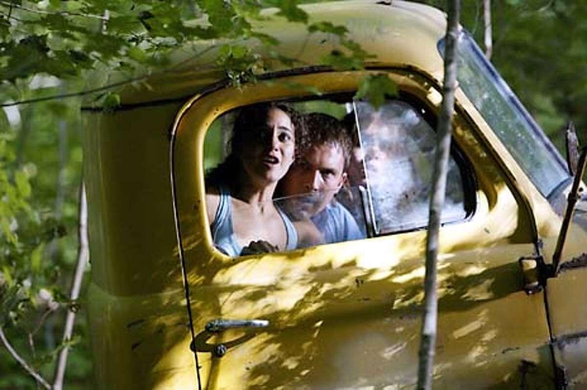 Carly (Emmanuelle Chriqui, left), Chris (Desmond Harrington) and Jessie (Eliza Dushku) react to the horrific events unfolding before them.