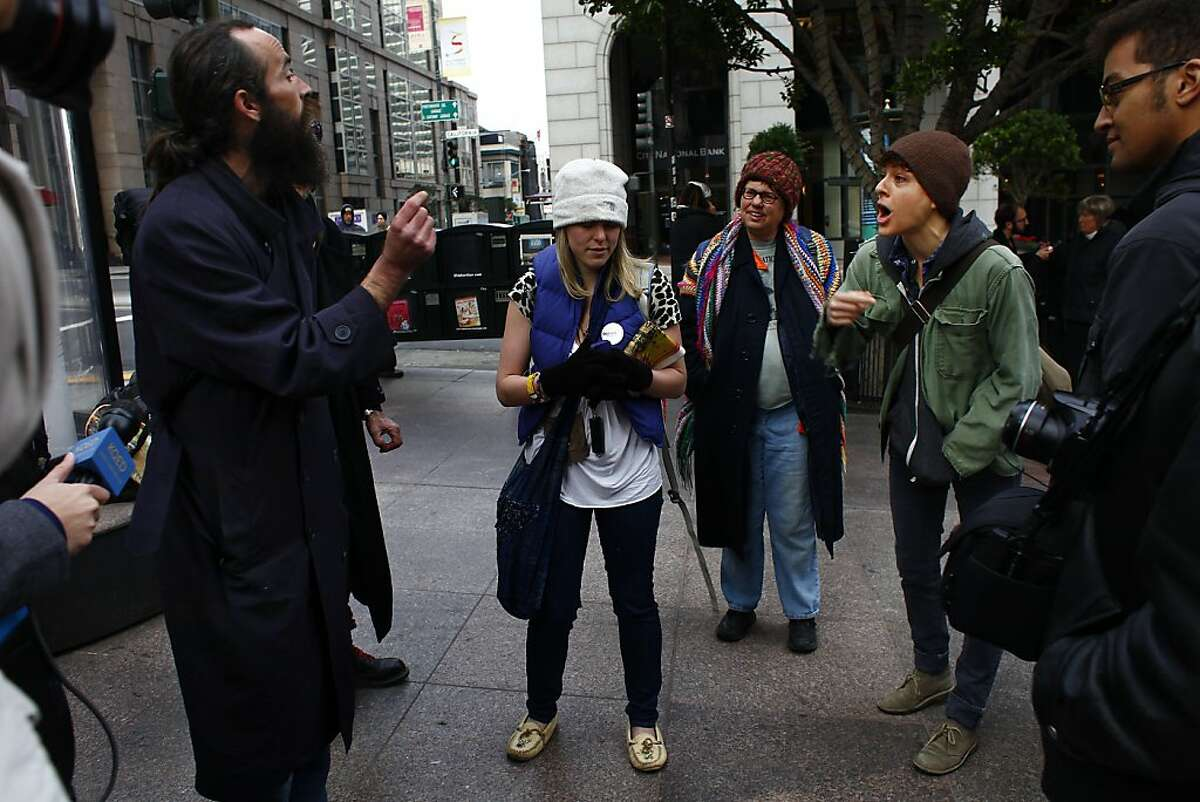 Rob Benson (left), Treasurer Occupy SF, debates with other Occupy SF protesters after they staged a rally and informational session in front of 555 California Street and gave a preview of events scheduled for Friday, when the group intends to do daylong protests on Wednesday, January 18, 2012 in San Francisco, Calif.