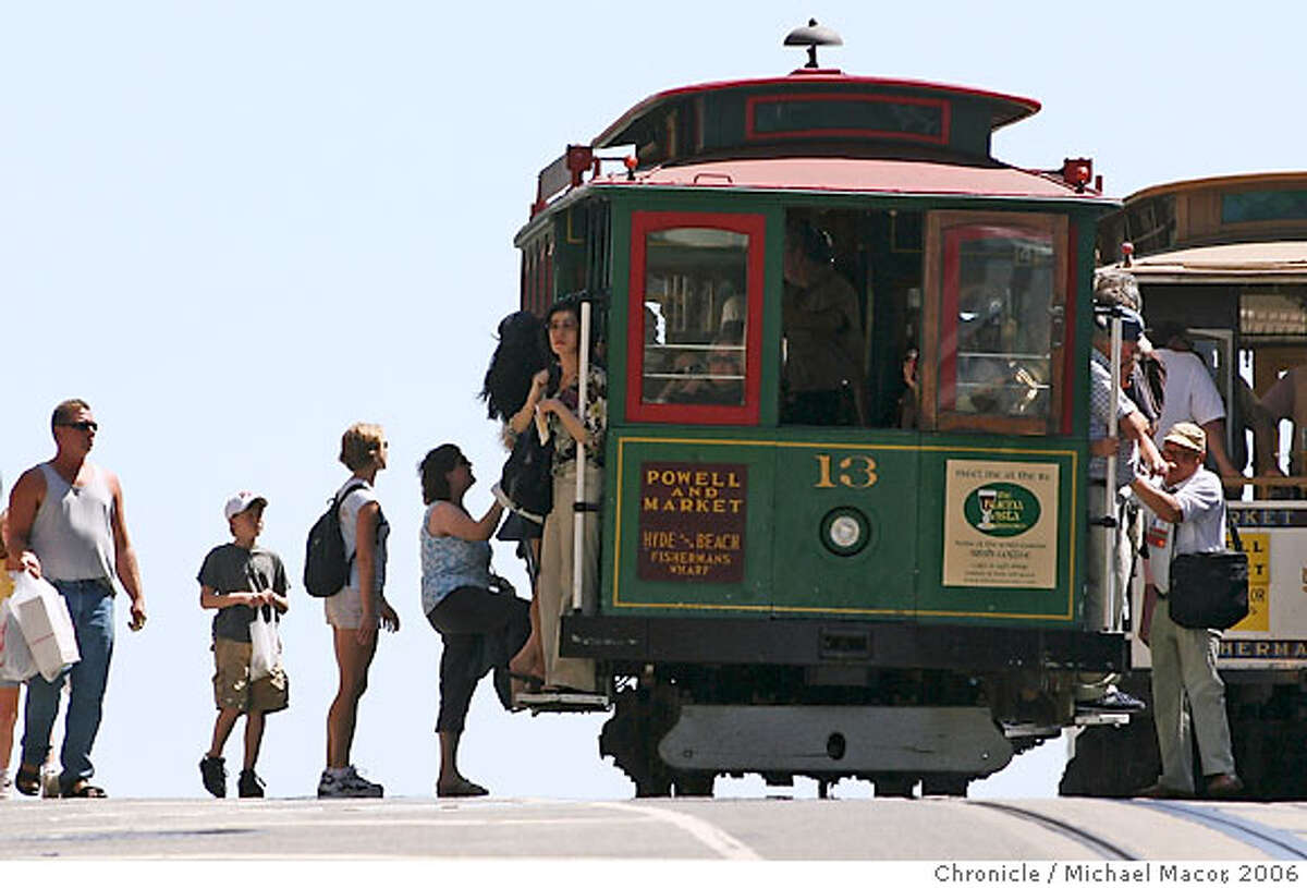 Tourists wait in line to board San Francisco's iconic cable cars