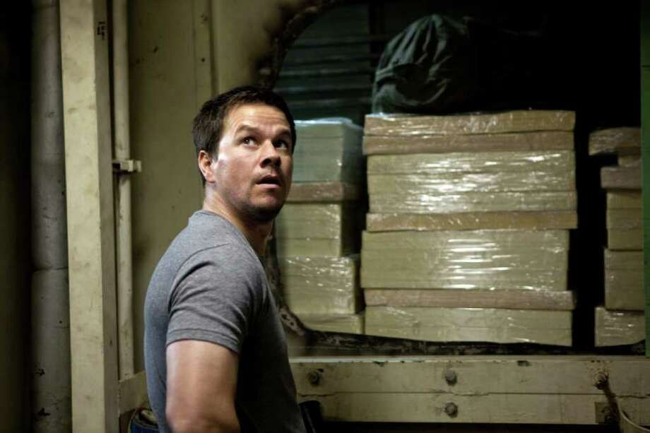 "In this film image released by Universal Pictures, Mark Wahlberg is shown in a scene from ""Contraband."" (AP Photo/Universal Pictures, Patti Perret) Photo: Patti Perret / Copyright: © 2012 Universal Studios. ALL RIGHTS RESERVED. Copyright: © 2012 Universal Studios. ALL RIGHTS RESERVED."