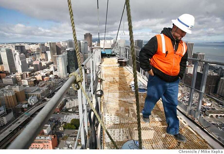 .JPG  Project Engineer for Bovis Lend Lease, Vincente Roman, walks along the top of the giant crane attached to the Rincon project in San Francisco. 2/28/07.  Mike Kepka / The Chronicle Vincente Roman (cq) the source MANDATORY CREDIT FOR PHOTOG AND SF CHRONICLE/NO SALES-MAGS OUT Photo: Mike Kepka