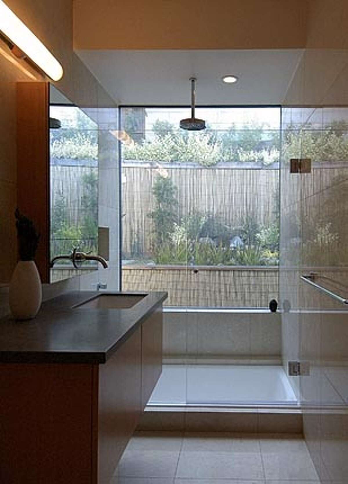 Switchable glass brings the garden into the shower of this small Noe Valley house.