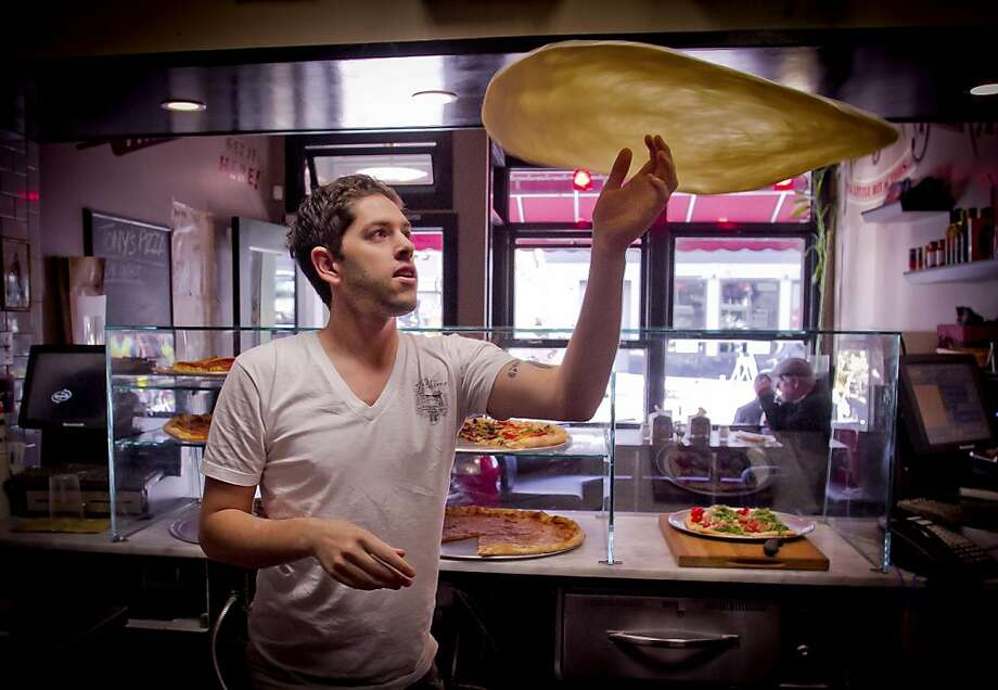 General manager Eric Cocbin tosses a pie at Tony's Coal-Fired Pizza in San Francisco, Calif., on Monday, December 5th,  2011. Photo: John Storey