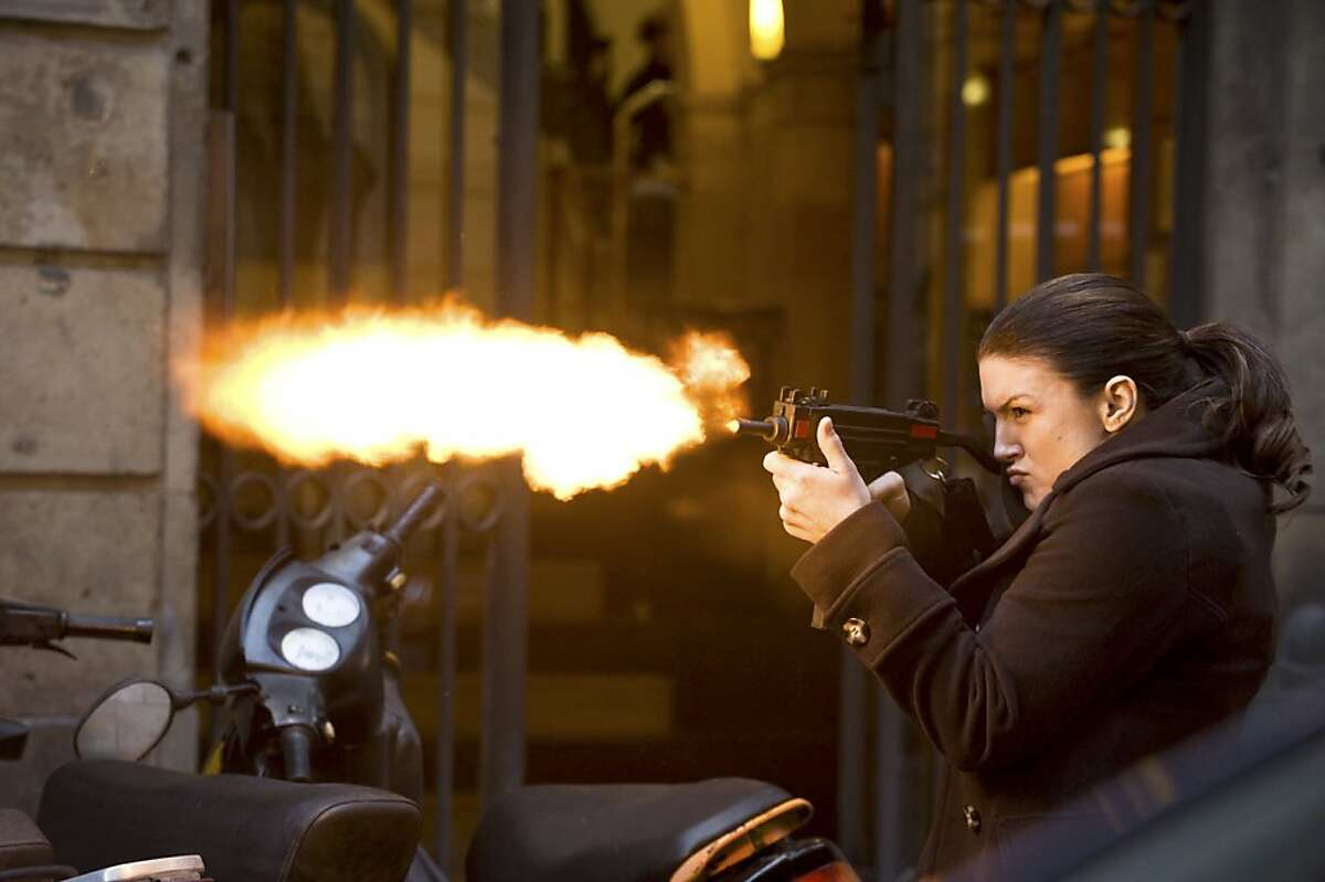 """An undated handout photo of Gina Carano in Steven Soderbergh's revenge thriller, """"Haywire."""" Carano, a mixed martial arts fighter, makes her major-film debut as a lethal covert operator in Soderbergh's film, which opens on Jan. 20, 2012. Claudette Barius/Five Continents Imports, via Relativity Media via The New York Times) -- NO SALES; FOR EDITORIAL USE ONLY WITH STORY SLUGGED FILM-HAYWIRE-ADV08 BY MARGY ROCHLIN. ALL OTHER USE PROHIBITED. -- PHOTO MOVED IN ADVANCE AND NOT FOR USE - ONLINE OR IN PRINT - BEFORE JAN. 8, 2012."""