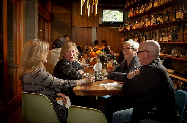 People enjoy the bar during Happy Hour at the Spoon Bar in Healdsburg, Calif., on Saturday, January 7th,  2012. Photo: John Storey, Special To The Chronicle