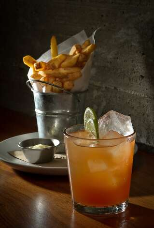 The Dark and Stormy Cocktail with French Fries at Spoon Bar in Healdsburg, Calif., is seen on Saturday, January 7th,  2012. Photo: John Storey, Special To The Chronicle
