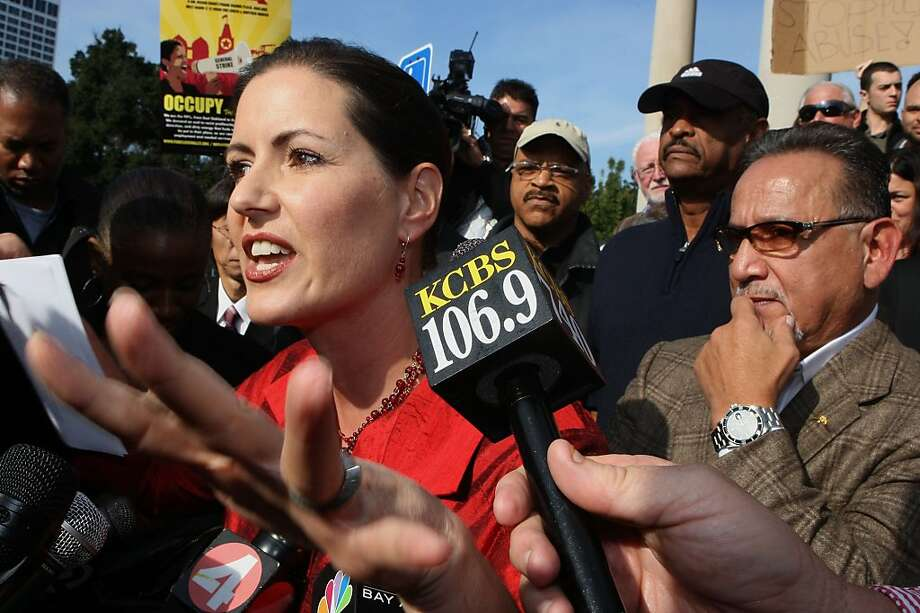 Oakland city councilmember  Libby Schaaf  (left) talks to the press at the bandstand next to Lake Merritt in 2011. Photo: Liz Hafalia, The Chronicle