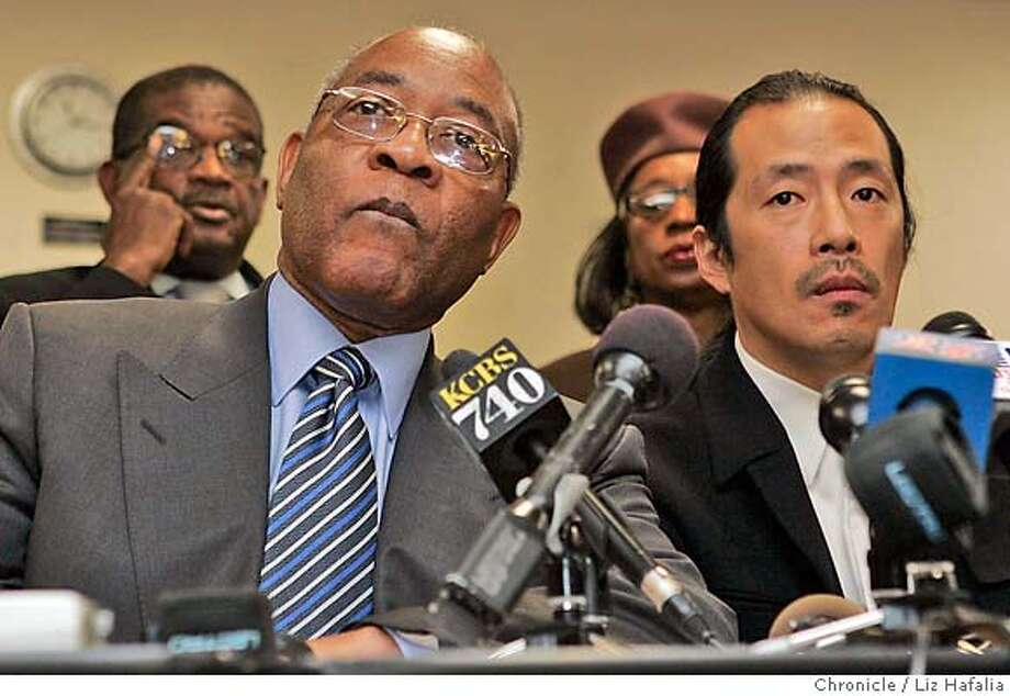 Amos Brown, president of the San Francisco NAACP (left), and AsianWeek Editor at large Ted Fang attend the news conference. Chronicle photo by Liz Hafalia