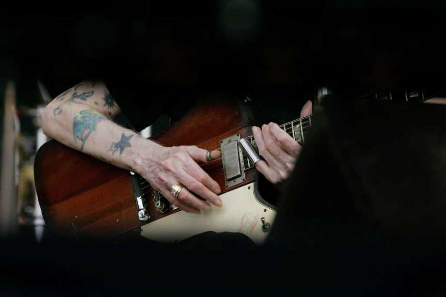 "The hands of Johnny Winter perform  ""Highway 61"" at the Crossroads Guitar Festival in Chicago, Saturday, July 28, 2007. (AP Photo/Charles Rex Arbogast) Photo: Charles Rex Arbogast, STF / AP2007"