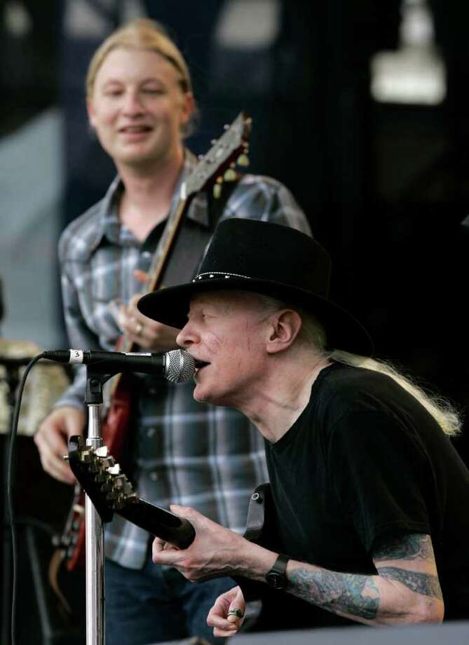 "Johnny Winter, seated, and Derek Trucks, background, perform ""Highway 61"" at the Crossroads Guitar Festival in Chicago, Saturday, July 28, 2007. (AP Photo/Charles Rex Arbogast) Photo: Charles Rex Arbogast, STF / AP2007"