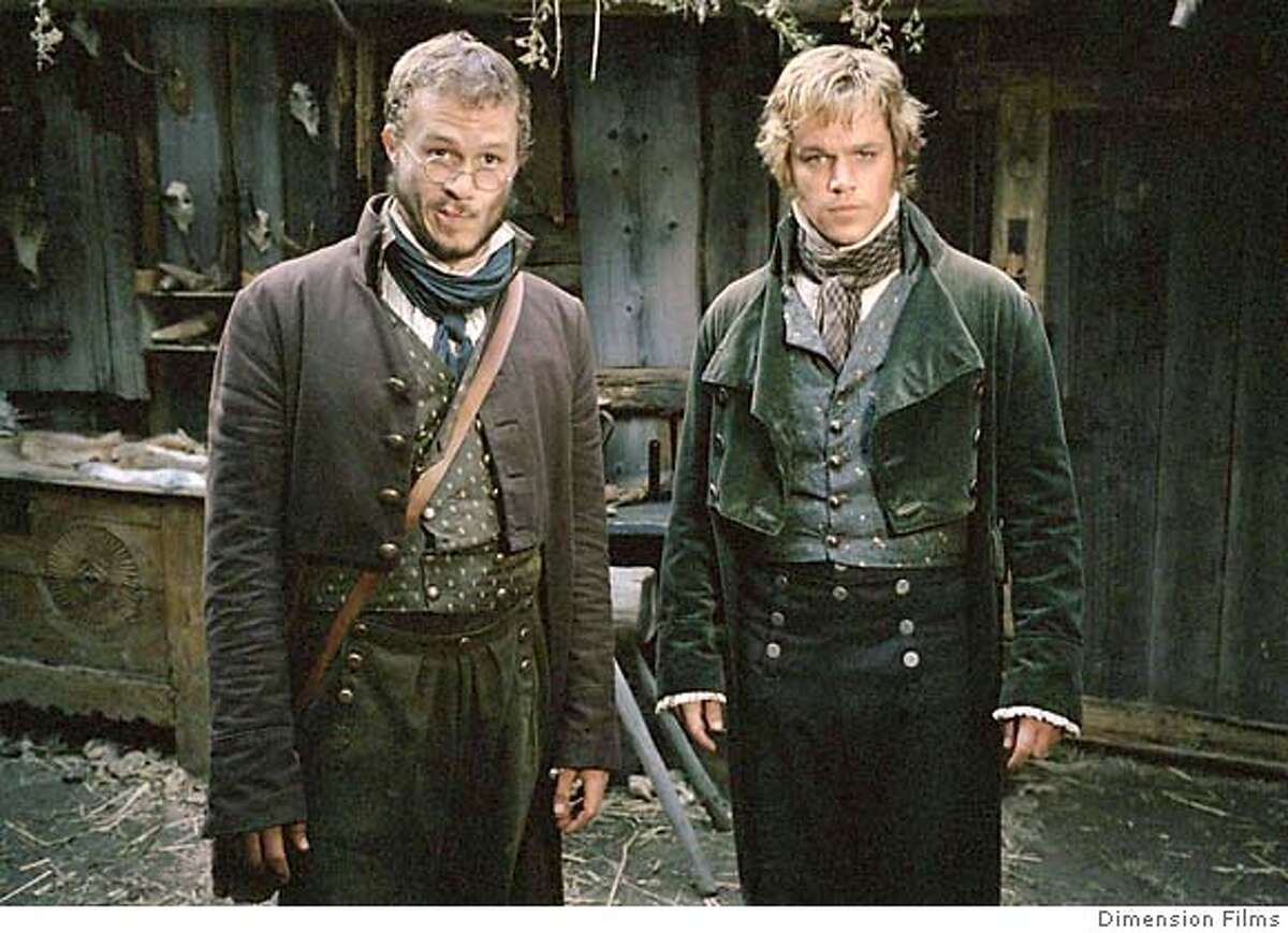 Actors Matt Damon (R) and Heath Ledger are the Grimm brothers in the movie