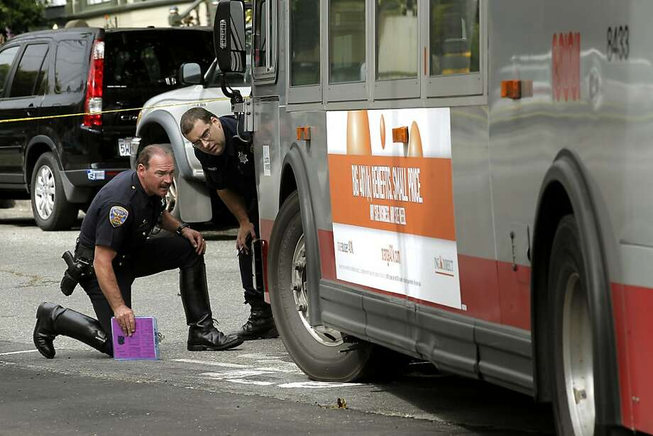 San Francisco police officers investigate the scene where a pedestrian was struck and killed by a MUNI bus at the corner of 18th street and Hartford in the Castro neighborhood on Friday August 19, 2011, in San Francisco, Ca. Photo: Michael Macor, The Chronicle