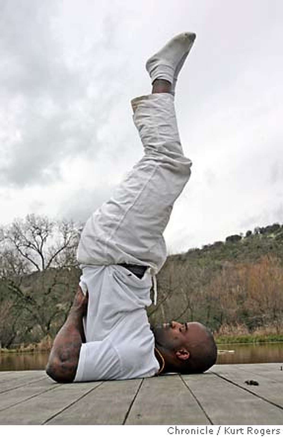At the Sivananda Ashram Yoga Farm in Grass Valley Rick Williams works out on a dock by the lake. Ricky Williams, the Heisman Trophy winning running back who went on to become an NFL star and then quit under a cloud of substance-abuse and other issues (not necessarily bad issues), basically disappeared for at time. He turned up in Grass Valley, CA, studying holistic therapy and such. Then he tried to come back to the NFL again; then he ended up playing in the Canadian Football League. He's now returned to Grass Valley TUESDAY, FEBRUARY 27, 2007 KURT ROGERS/THE CHRONICLE GRASS VALLEY THE CHRONICLE SFC WILLIAMS_0089_kr.jpg MANDATORY CREDIT FOR PHOTOG AND SF CHRONICLE / NO SALES-MAGS OUT